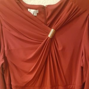 Stunning red dress with gold accent.